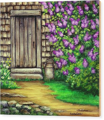 Lilacs By The Barn Wood Print by Sandra Estes