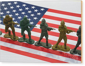 Line Of Toy Soldiers On American Flag Crisp Depth Of Field Wood Print by Amy Cicconi