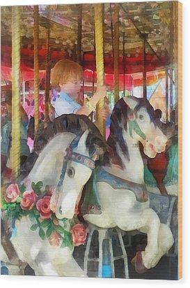 Little Boy On Carousel Wood Print by Susan Savad