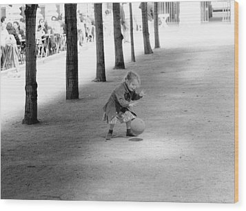 Little Girl With Ball Paris Wood Print by Dave Beckerman
