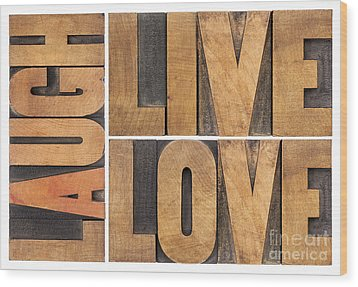 Wood Print featuring the photograph Live Love And Laugh In Wood Type by Marek Uliasz