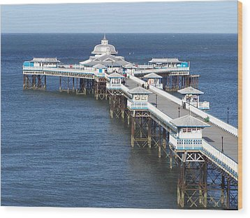 Wood Print featuring the photograph Llandudno Pier by Christopher Rowlands