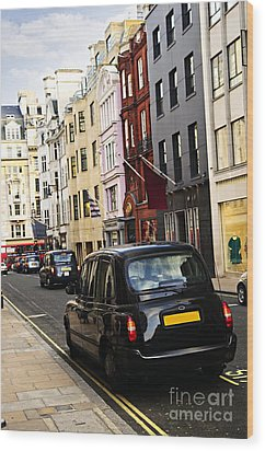 London Taxi On Shopping Street Wood Print by Elena Elisseeva