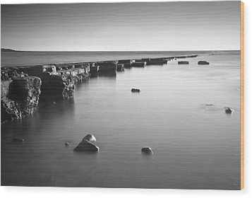 Long Exposure Image Of Tide Going Out Over Rock Ledge During Sun Wood Print by Matthew Gibson
