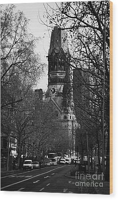 looking down Kurfurstendamm towards Kaiser Wilhelm Gedachtniskirche memorial church Berlin Germany Wood Print by Joe Fox