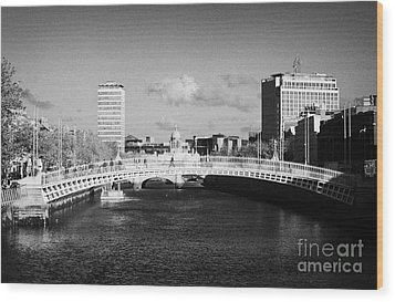 Looking Down The Liffey Towards The Hapenny Ha Penny Bridge Over The River Liffey In Dublin Wood Print by Joe Fox