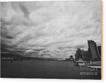 looking out from coal harbour into Vancouver Harbour on an overcast cloudy day BC Canada Wood Print by Joe Fox