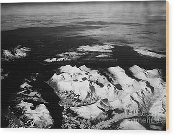Looking Out Of Aircraft Window Over Snow Covered Fjords And Coastline Of Norway Northern Europe Wood Print by Joe Fox