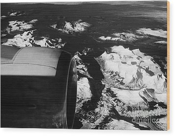 Looking Out Of Aircraft Window Past Engine And Over Snow Covered Fjords And Coastline Of Norway Euro Wood Print by Joe Fox