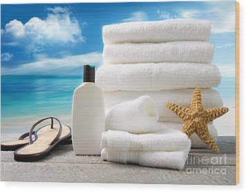 Lotion  Towels And Sandals With Ocean Scene Wood Print by Sandra Cunningham