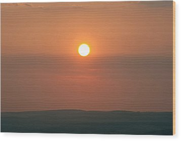 Low Setting Sun Over Distant Landscape Wood Print by Matthew Gibson