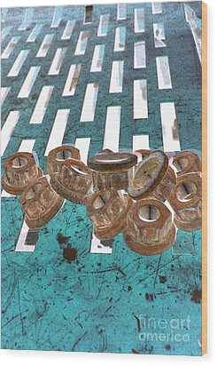Lug Nuts On Grate Vertical Turquoise Copper Wood Print by Heather Kirk