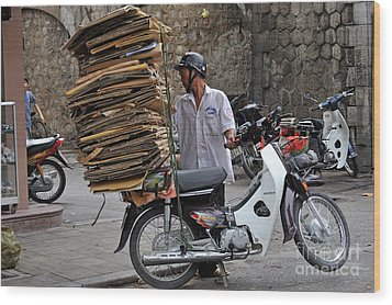 Man Carrying Cardboard On The Back Of His Scooter Wood Print by Sami Sarkis