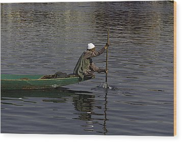 Man Plying A Wooden Boat On The Dal Lake Wood Print