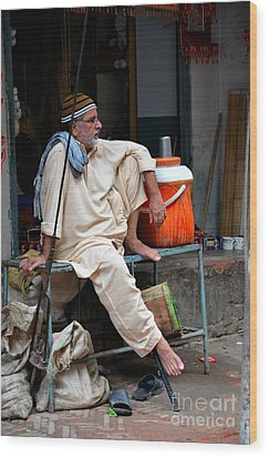 Man Sits And Relaxes In Lahore Walled City Pakistan Wood Print by Imran Ahmed