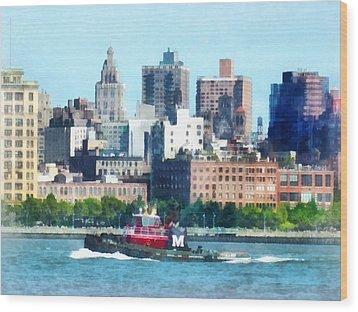 Manhattan - Tugboat Against Manhattan Skyline Wood Print by Susan Savad