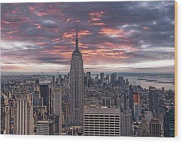 Manhattan Under A Red Sky Wood Print by Joachim G Pinkawa
