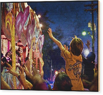 Mardi Gras At Night Wood Print by Ray Devlin