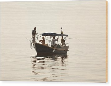 Men Go Fishing From A Boat Wood Print by Serhii Odarchenko