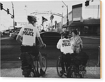 metro police bicycle cops help a tourist with directions in downtown Las Vegas Nevada USA Wood Print by Joe Fox
