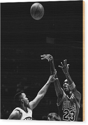 Michael Jordan Shooting Over Another Player Wood Print by Retro Images Archive