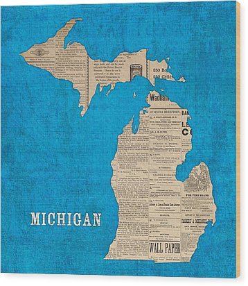 Michigan Map Made Of Vintage Newspaper Clippings On Blue Canvas Wood Print
