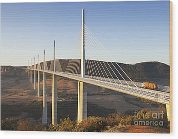 Millau Viaduct At Sunrise Midi Pyrenees France Wood Print by Colin and Linda McKie