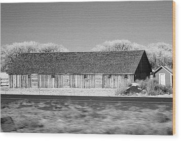 Montana Building Wood Print by Paul Bartoszek