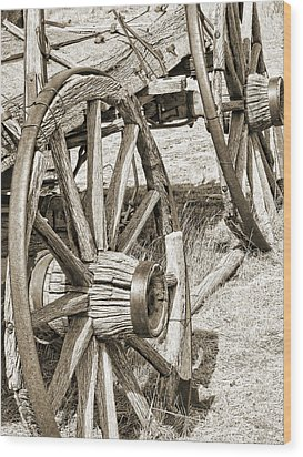 Montana Old Wagon Wheels In Sepia Wood Print by Jennie Marie Schell