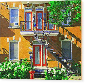 Montreal Art Seeing Red Verdun Wooden Doors And Fire Hydrant Triplex City Scene Carole Spandau Wood Print by Carole Spandau