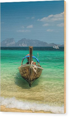 Moored Longboat Wood Print by Adrian Evans
