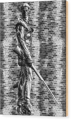 Mountaineer Statue With Black And White Brick Background Wood Print