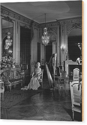 Mrs. Cornelius Sitting In A Lavish Music Room Wood Print by Cecil Beaton
