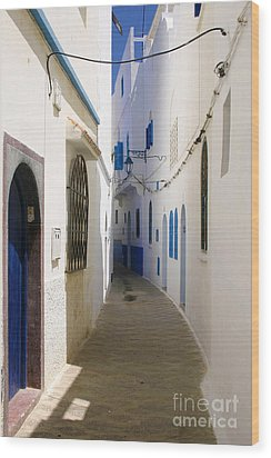 Wood Print featuring the photograph Narrow Backstreet In The Medina Of Asilah On Northwest Tip Of Atlantic Coast Of Morocco by Ralph A  Ledergerber-Photography