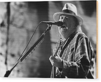 Neil Young Performing At Farm Aid In Black And White Wood Print by Jennifer Rondinelli Reilly - Fine Art Photography