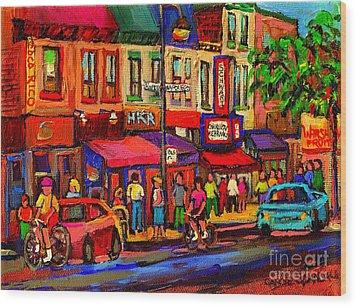 Night Riders On The Boulevard Rue St Laurent And Napoleon Deli Schwartz Montreal Midnight City Scene Wood Print by Carole Spandau