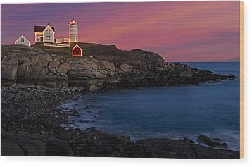 Nubble Lighthouse At Sunset Wood Print by Susan Candelario