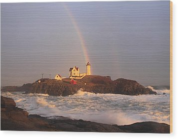 Nubble Lighthouse Rainbow And High Surf Wood Print by John Burk