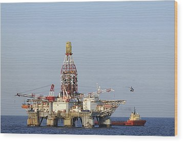 Wood Print featuring the photograph Off Shore Oil Rig With Helicopter And Boat by Bradford Martin
