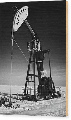 oil pumpjack in winter snow Forget Saskatchewan Canada Wood Print by Joe Fox