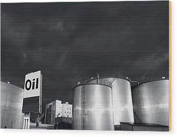 Oil Refinery At Sunset With Commercial Sign Wood Print
