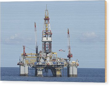 Oil Rig And Helicopter Wood Print by Bradford Martin