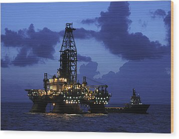Wood Print featuring the photograph Oil Rig And Vessel At Night by Bradford Martin
