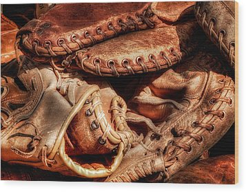 Old Baseball Gloves Wood Print by Bill Wakeley