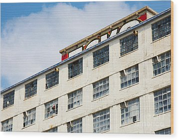 Wood Print featuring the photograph Old Factory Under A Clear Blue Sky by Nick  Biemans