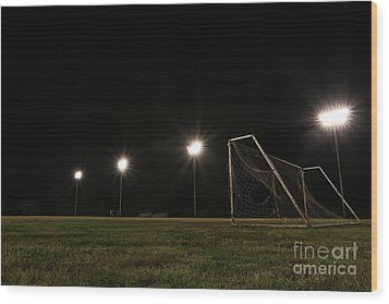 Old Grunge Soccer Goal On A Lit Field At Night Wood Print