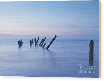 Old Jetty Posts At Sunrise Wood Print by Colin and Linda McKie