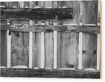 old patched up wooden fence using old bits of wood in snow Forget Wood Print by Joe Fox