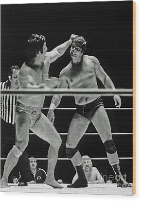 Wood Print featuring the photograph Old School Wrestlers Dean Ho And Don Muraco Battling It Out In The Middle Of The Ring by Jim Fitzpatrick