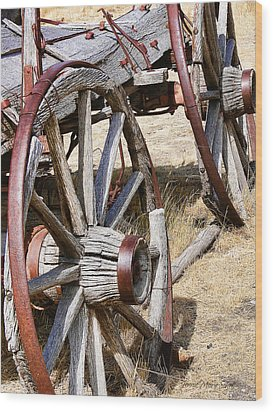 Old Wagon Wheels From Montana Wood Print by Jennie Marie Schell